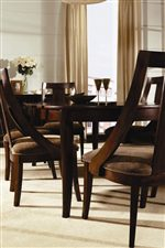 Sleek Table Leg & Sloped Arm Detail on Dining Chairs