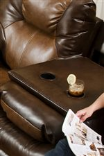 The Middle Seat of the Reclining Sofa Flips Down to Provide Two Additional Beverage Holders