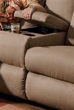 Console Unit in Sofa Provides Beverage Holders and Covered Storage Space