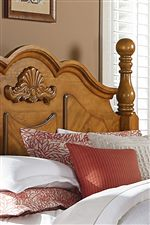 Gracefully shaped crown, cannonball poster bed, and veneer patterned overlay panels