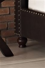 Base Features Nail Head Trim and Wood Bun Feet with Dark Brown Finish