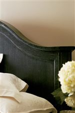 Panel Bed Has a Gracefully-Sloped Headboard
