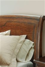 Cross-Grain Quartered Walnut Inlay Encircles the Sleigh Bed's Headboard