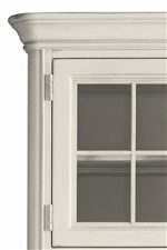 Thick Stepped Crown Molding and Window Pane Details Complete the Rustic Cottage Feel of the Collection