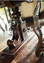 Gentle Curves of Iron Detail Compliment Bold Trestle Base