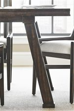 Industrial Style Metal Banding Along Edge and Angled Legs on Rectangular Table
