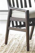 Dining Chairs Feature Upholstered Slip Seats, Low Arms, and Slat Detailing