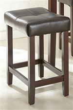 Stool with Brown Leather-like Cushion on Tapered Legs with Stretchers