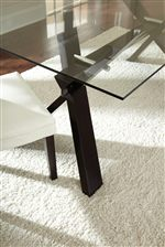 Table Features a Stunning Glass Top Over an Angled Trestle Base