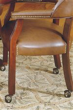 Brass Nail Head Trim and Casters on Arm Chair.