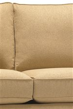 Plush Upholstered Seat Backs and Thick Seat Cushions Create a Comfortable Seating Space for Soft Relaxation