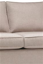 Plush Upholstered Seat Cushions and Back Cushions Create a Soft Seating Area for Comfortable Relaxation