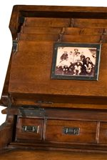 A Scrapbook Style Lift Top Creates a Desk Writing Surface with Built In Picture Frames