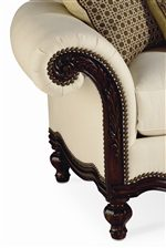 Elaborate Rolled Arm with Carved Wood Accents and Decorative Nail Head Trim