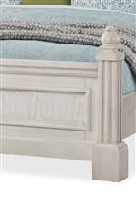 The bed with traditional posts and carved tulip finials is primed to become an heirloom in your family