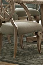 Upholstered pieces come standard in complementing taupe fabric