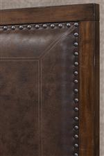 Upholstered Headboard Lined in Nailhead Trim