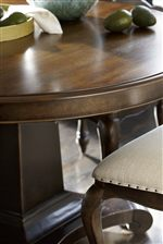 Kitchen Table Features a Round Table Top and Pedestal Base