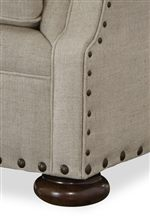 Stacked Bun Feet and Nailhead Trim Highlight Traditional Detailing