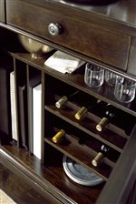 The Proximity Dining Cabinet Contains Designated Storage Spaces For Wine Bottles and Serving Platters, Along with Adjustable Shelves