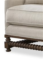 Between each leg is a horizontal spool turned piece in a bohemian oak wood finish.