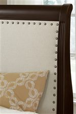 Upholstered Sleigh Headboard with Nailhead Trim