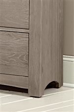 Arched Shapes at Base and Block Feet on Storage Pieces