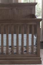 Crib has crown moulding and raised panels for additional style