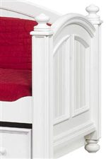 Raised panels, turned finials, plank detailing, and bun feet are featured throughout the collection