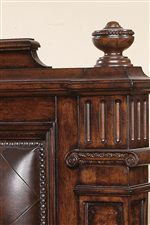 Carved Finials and Posts Accentuate the Group's Manor-Inspired Style