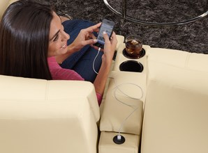 Woman Charging Cell Phone at Reclining Loveseat USB Port