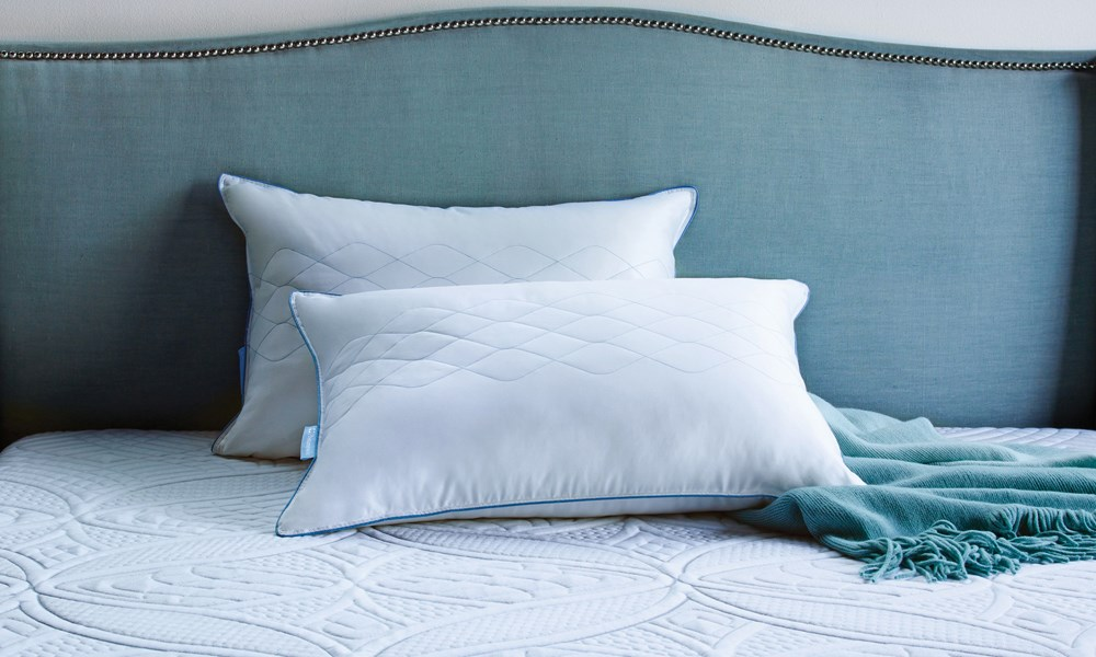 Sealy Posturepedic Mattress with Two Pillows, Turquoise Throw, and Turquoise Headboard with Nailhead Trim