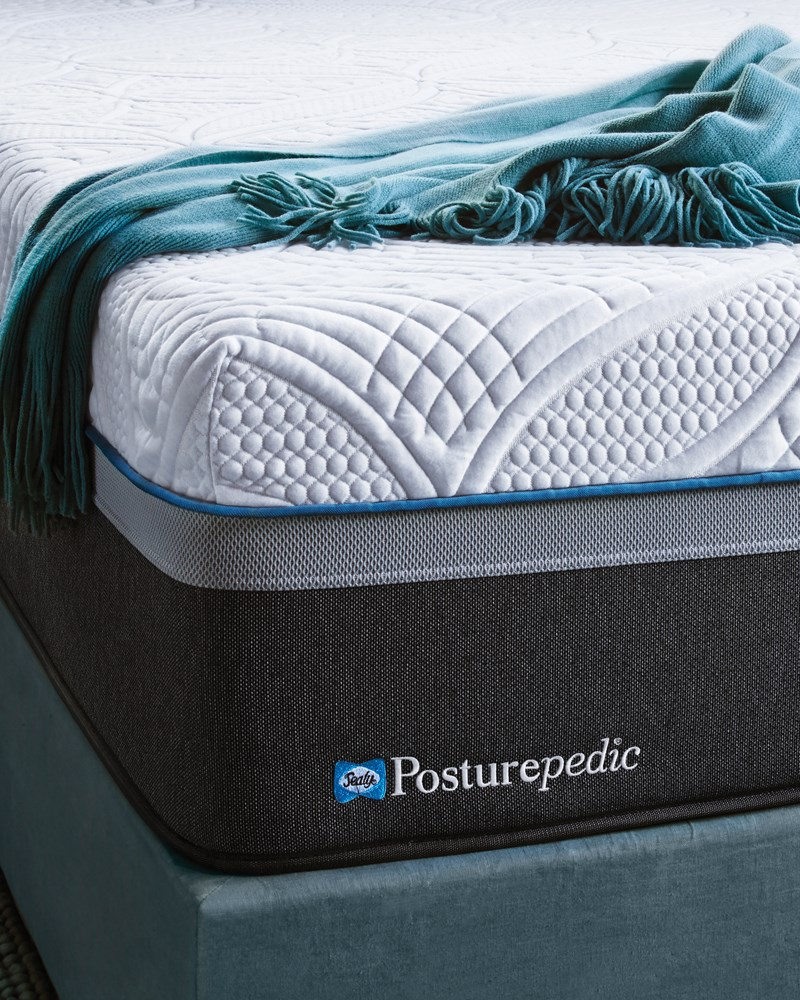 Sealy Posturepedic Mattress with Turquoise Thrown Blanket
