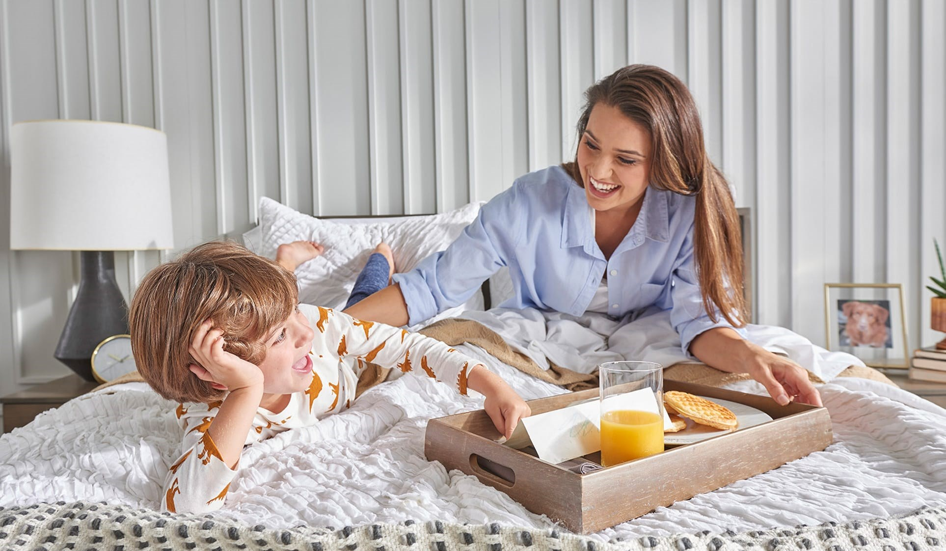 Mother and son eating breakfast in bed Mobile
