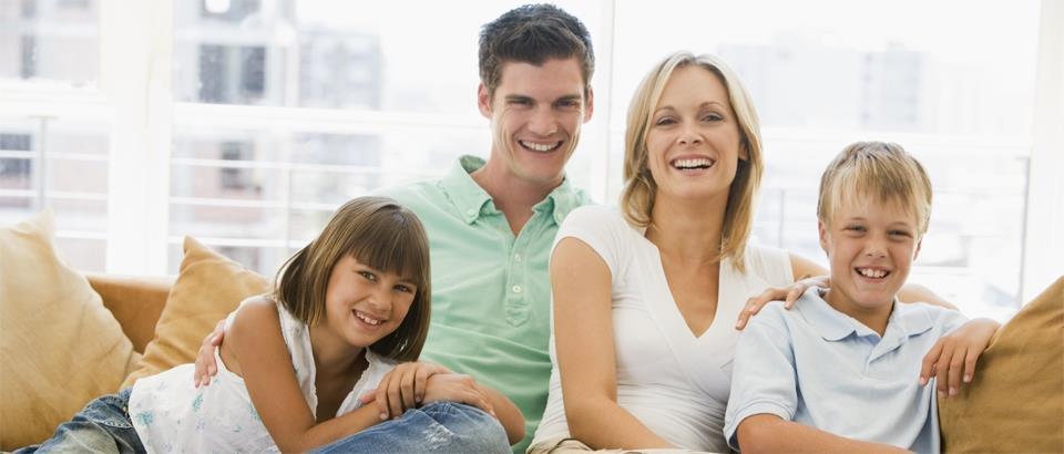 Happy family on a sofa