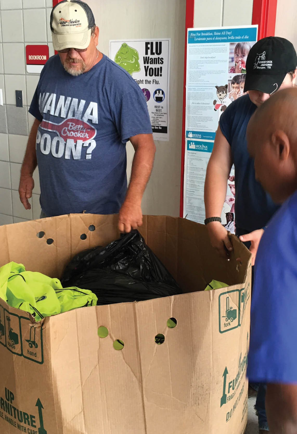 unloading donations from a box