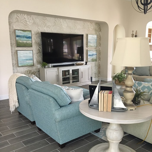 living room with a blue couch and white side table