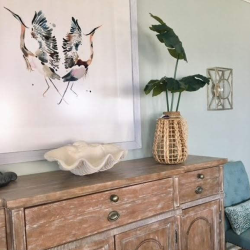 wooden chest of drawers with beachy decor pieces