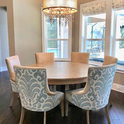 small dining table with blue and white chairs