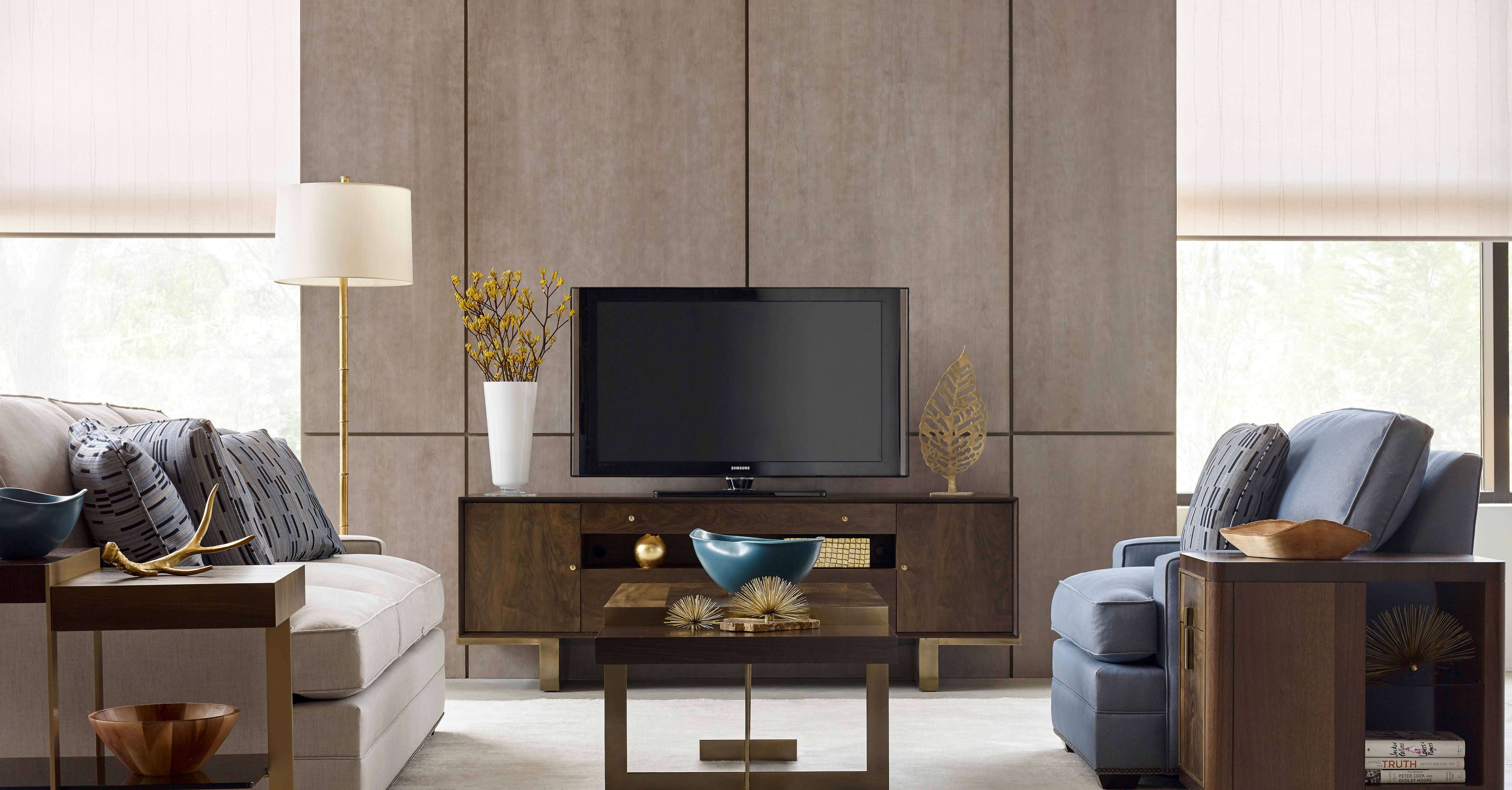 photo of a home entertainment setting with a tv stand, coffee table, and side table