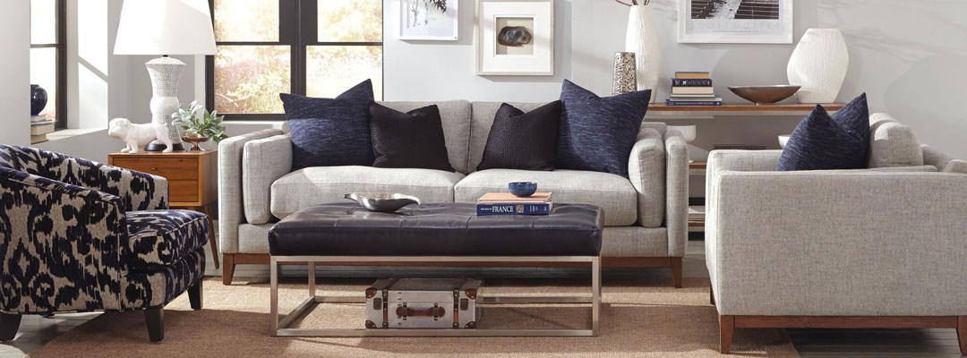 grey sofa and tufted cocktail ottoman
