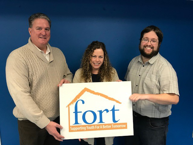 People holding a Fort sign
