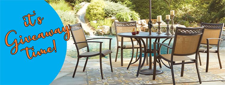 Brown metal patio set with pool in the background
