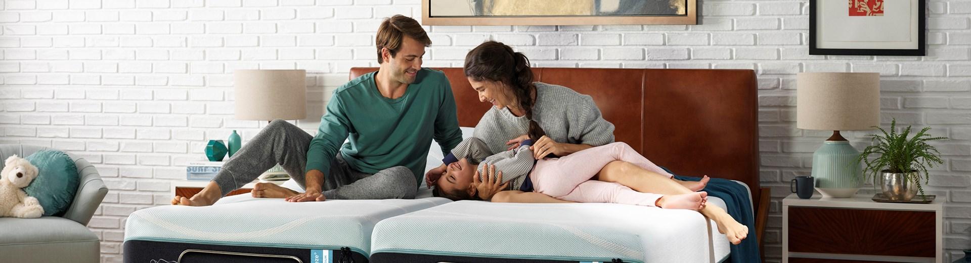 Family laying on mattress