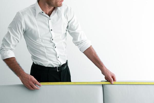 Man measuring a sofa