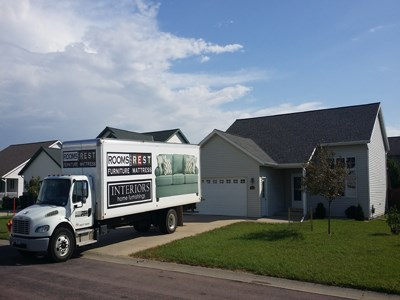 Rooms and Rest delivery truck in driveway of customer's house.