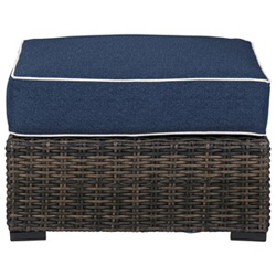 Brown woven ottoman with blue cushion