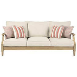 Light brown woven seating with white cushions