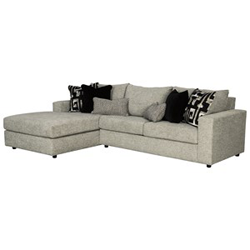White upholstered sectional with black accent pillows