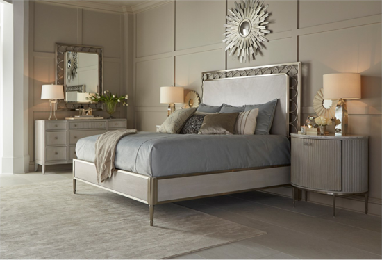 Bedroom with white and grey accents and gold bed